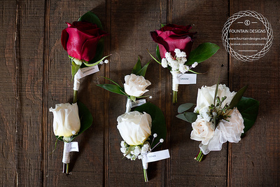 Boutonniere- Rose- $11.95, Rose w/ Babies Breath- $12.95, Corsage- $18.95, Spray Rose Bout- $9.95