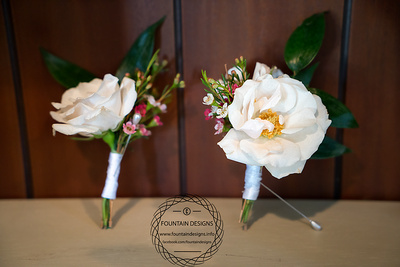Double spray rose boutonniere- $13.95  Spray rose boutonniere- $11.95